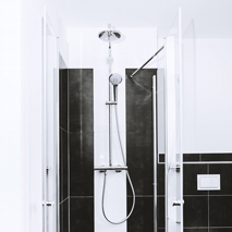 Floor-to-ceiling shower with large-format tiles